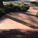 New brick pathway. Basket weave pattern in the circle and soldier course through the curved path
